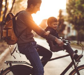 A father with his son on a bike